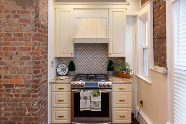 New Troy Kitchen Remodel with decorative cabinetry hood